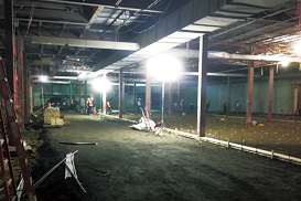 Balloon lights illuminate a construction site.