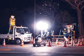 LED balloon light tower illuminates a road maintenance work.