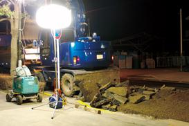 A balloon light illuminates resurfacing job-site.