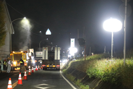 A number of balloon light towers are being used at night road maintenance.